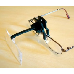 Clip on magnifier with 4 lenses